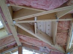 Cathedral ceiling framing with insulation and ventilation baffles