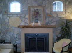 New gas fireplace and stone wall facing