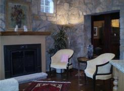 New family room area with stone facing and gas fireplace