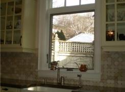 New kitchen window with arched transom