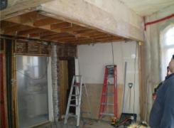 New beams supporting second floor above