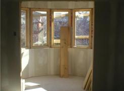 Second floor cantilevered semi circular window in progress