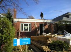 Existing roof removed and second floor framing in progress
