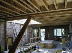 First floor interior with second floor framing above in progress