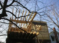 Rear cantilevered addition framing in progress