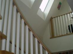 Atrium with skylights & curved stairs