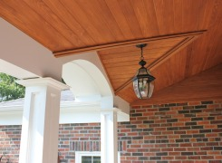 Front verandah entry arch detail with cedar ceiling