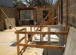 First floor masonry walls remain and braced for additions above