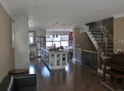 New first floor living, kitchen, dining areas and stairs