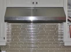 New kitchen glass backsplash gas range and stainless hood