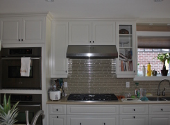 New kitchen with glass backsplash stainless hood