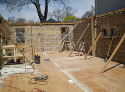 First floor exterior masonry walls braced in preparation for second and third storey addition above