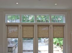 Sunroom glass french doors with transoms facing garden