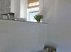 Breakfast sunroom area with kitchen beyond
